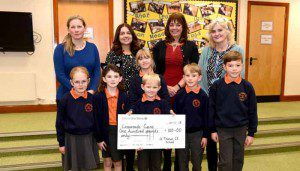 Cheque presentation with St Thomas School £100